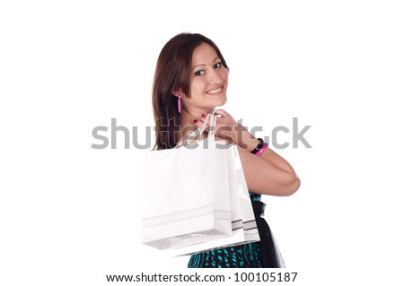 Portrait of smiling young woman carrying shopping bags against white background