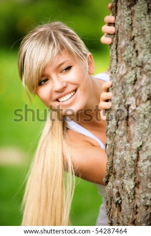 Portrait of smiling young woman close up on green background.