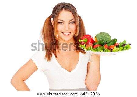 portrait of smiling young woman holding vegetables. isolated on white background