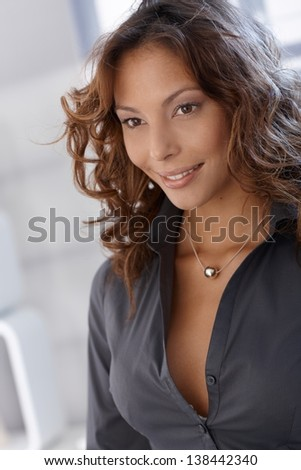 Portrait of smiling young woman looking away.