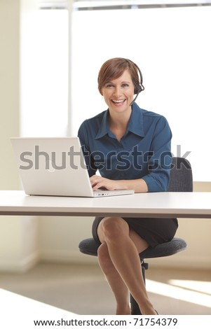 Portrait of smiling young woman telemarketer