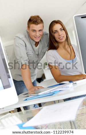 Portrait of smilng young business people - stock photo