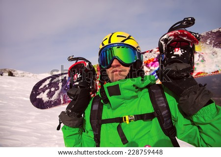 Portrait of snowborder against a background of the winter sky - stock photo