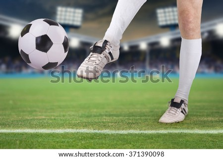 Portrait of soccer Player, shoots the soccer ball in Stadium