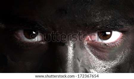 portrait of soldier face with jungle camouflage - stock photo