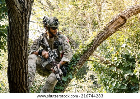 Portrait of Soldier in uniform of the U.S. Army on the trees