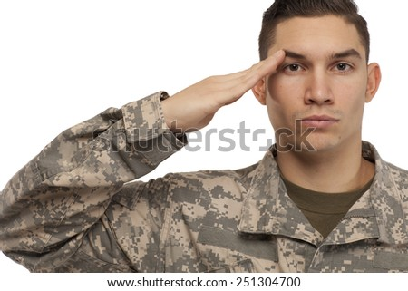 Portrait of soldier saluting against white background - stock photo