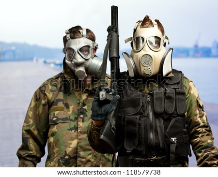 Portrait Of Soldiers With Gun And Gas Mask, Outdoor - stock photo