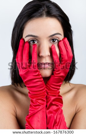 Portrait of sophisticated young woman with red dress - stock photo