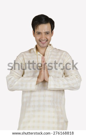 Portrait of South Indian man greeting - stock photo