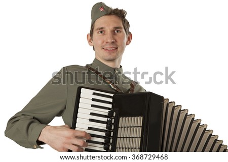 Portrait of Soviet soldier in uniform of World War II playing the accordion isolated on white background