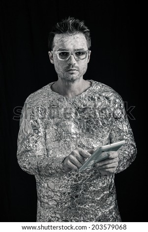 Portrait of spaceman using digital tablet. - stock photo