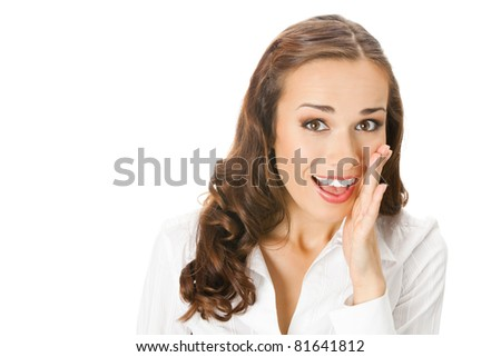 Portrait of speaking young business woman covering with hand her mouth, isolated on white background - stock photo