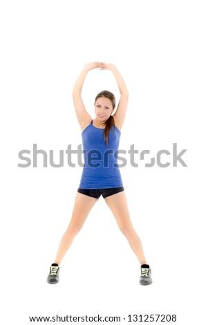 portrait of sport girl doing stretching exercise, studio shot over white background - stock photo