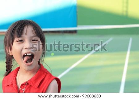 Portrait of sporty beautiful asian girl tennis player - stock photo