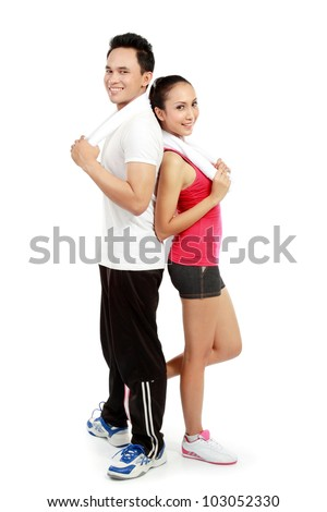 Portrait of sporty healthy young woman and man isolated on white background - stock photo