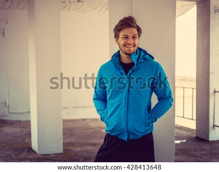 Portrait of sporty man in a blue jacket.