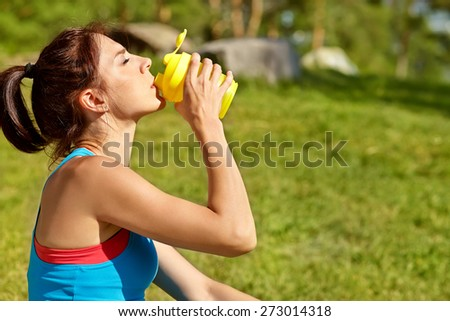 Portrait of sporty smiling woman with a water bottle. outdoor sports. healthy sport lifestyle - stock photo