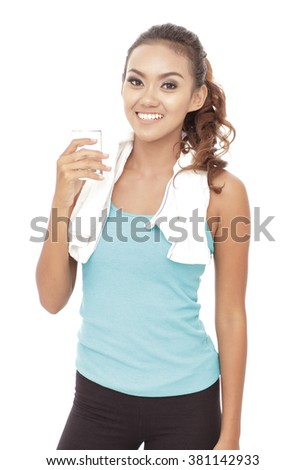 portrait of sporty woman having refreshments when break after workout isolated on white background
