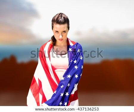 Portrait of sporty woman holding American flag against composite image of landscape