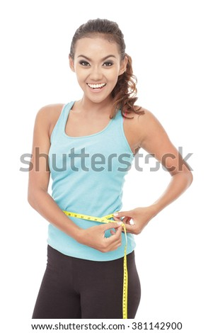 portrait of sporty woman measures her waist with measuring tape isolated on white background