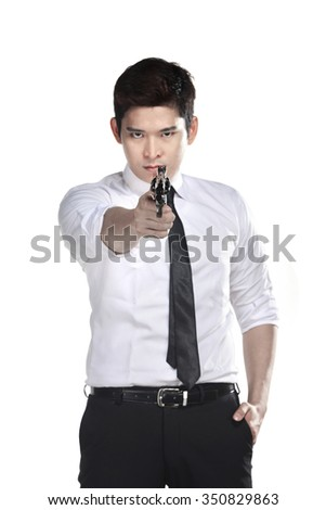 Portrait of srcret agent holding a gun isolated over a white background