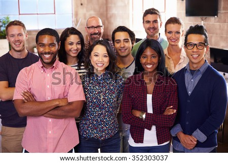 Portrait Of Staff Standing In Modern Design Office