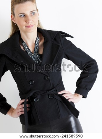portrait of standing woman wearing black clothes - stock photo