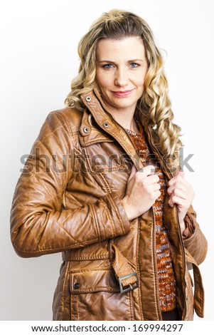 portrait of standing woman wearing brown jacket
