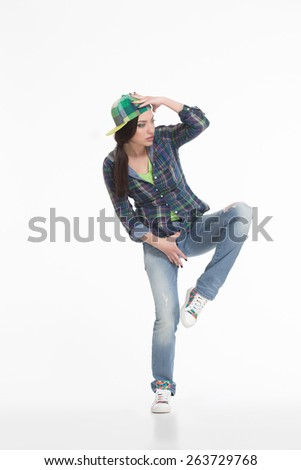 Portrait of street dancer in cap on white background - stock photo