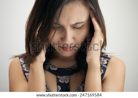 Portrait of stressed business woman with a headache - stock photo