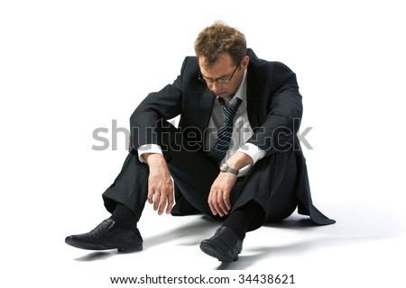 Portrait of stressed businessman left to the mercy of fate - stock photo