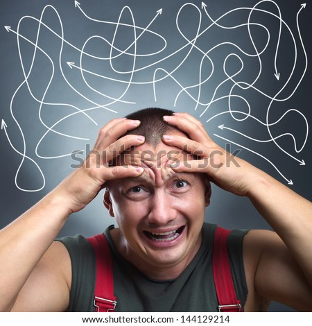 Portrait of stressed man with many arrows pointed in different directions - stock photo