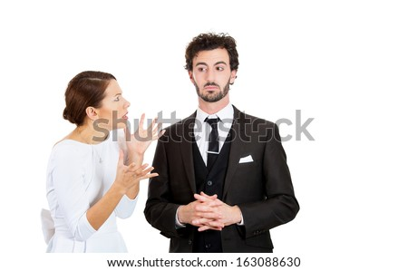 Portrait of stressed young couple going through hard times in relationship, isolated on white background. Upset, angry, mad wife, girlfriend trying to prove her point to clueless, annoyed man, husband - stock photo