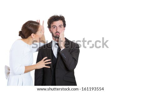 Portrait of stressed young couple going through hard times in their relationship, isolated on a white background . Wife, girlfriend trying to explain something to man, yelling, he is annoyed, stressed - stock photo