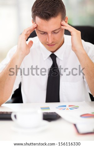 portrait of stressful businessman at work - stock photo