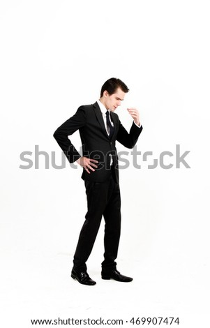 Portrait of stressful male worker in office  while holding his head, isolated on white