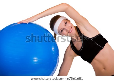 Portrait of strong girl lifting fitball on a white background - stock photo