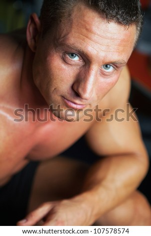 Portrait of strong handsome man - studio shot - stock photo