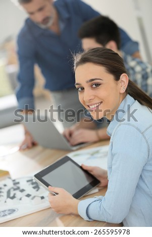 Portrait of student girl using digital tablet in class