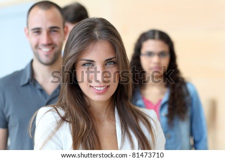 Portrait of student standing in front of group - stock photo