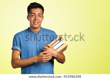 portrait of student with books - stock photo