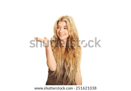 Portrait of student woman holding copyspace. - stock photo
