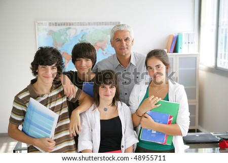 Portrait of students with teacher - stock photo
