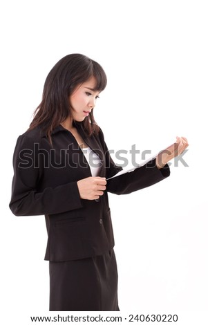 portrait of stunned, surprised, negative, frustrated asian business woman executive looking at document, isolated white background