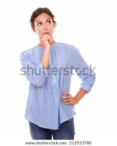 Portrait of stylish adult woman asking herself a question while looking to her left up and standing on isolated white background - copyspace - stock photo