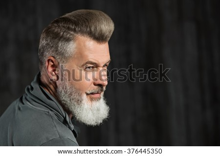 Portrait of stylish handsome adult man with beard. Man looking aside - stock photo