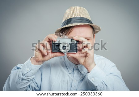 portrait of stylish handsome man with camera - stock photo