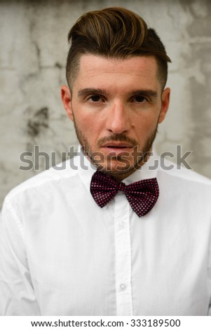 Portrait of stylish man outdoors wearing necktie - stock photo