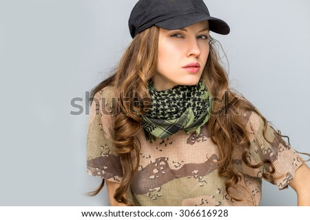 Portrait of stylish woman in military clothes